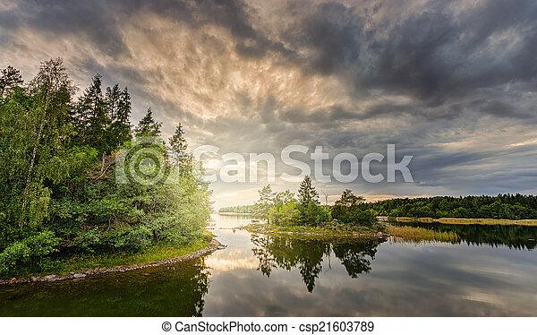Sunset over a scandinavian coastal landscape - csp21603789