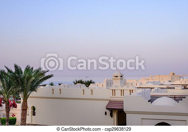 Sunset over a tropical resort complex - csp29638129