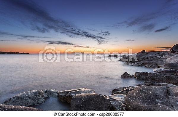 Sunset over Algajola beach in Corsica - csp20088377