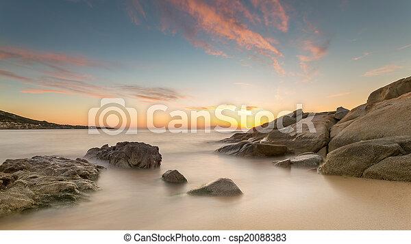 Sunset over Algajola beach in Corsica - csp20088383