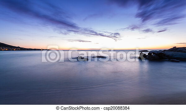 Sunset over Algajola beach in Corsica - csp20088384