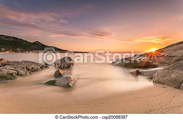 Sunset over Algajola beach in Corsica - csp20088387