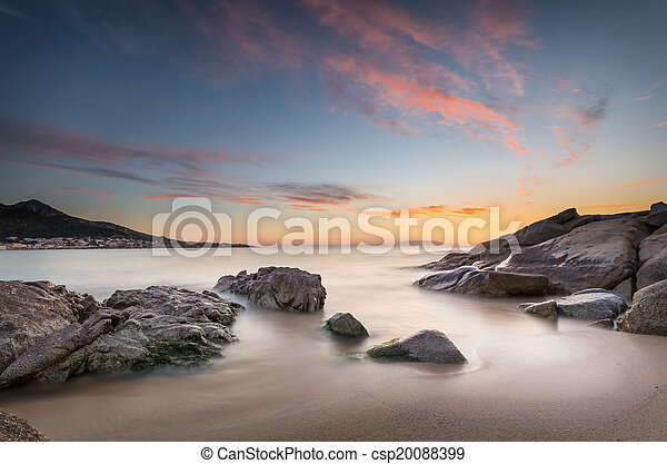 Sunset over Algajola beach in Corsica - csp20088399