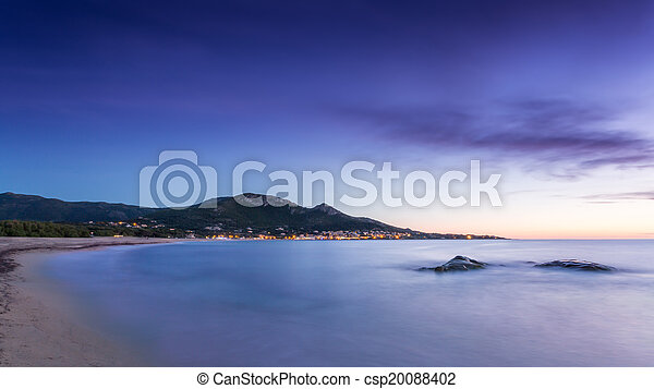 Sunset over Algajola beach in Corsica - csp20088402