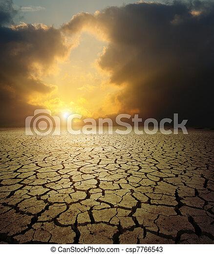 sunset over barren land - csp7766543