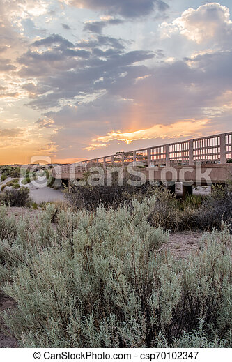 Sunset Over Bridge in Desert - csp70102347
