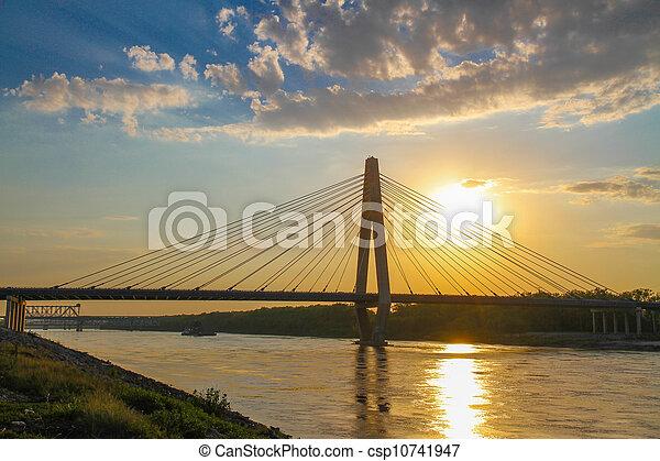 sunset over bridge - csp10741947