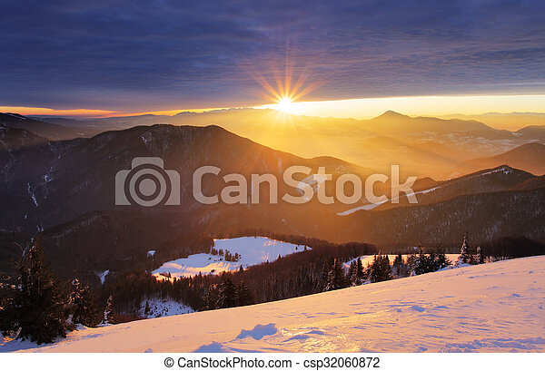 Sunset over color mountain silhouette with rays - csp32060872