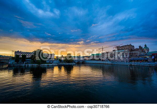 Sunset over Helgeandsholmen and Norrmalm, in Stockholm, Sweden. - csp30718766