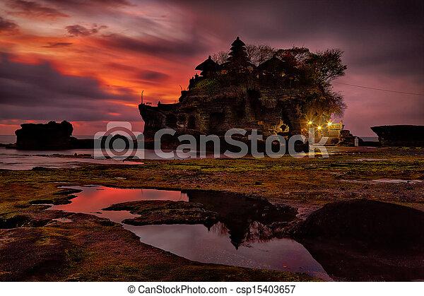 sunset over hindu temple Pura Tanah Lot, Bali - csp15403657
