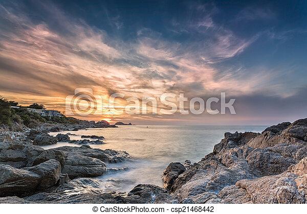 Sunset over Ile Rousse in Corsica - csp21468442