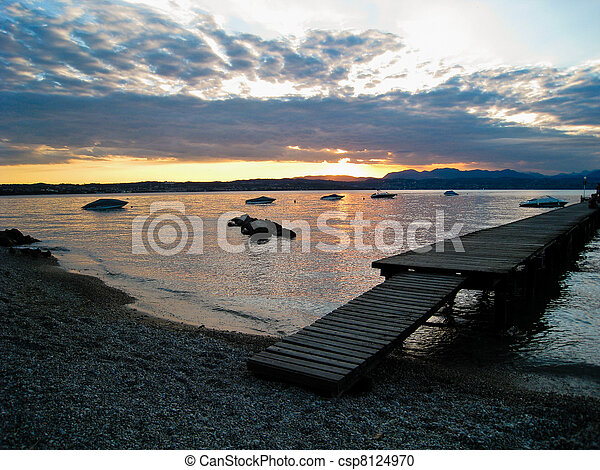 Sunset over Lago di Garda, Italy with Boats and Dock - csp8124970