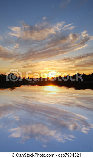 Sunset over lake - csp7934521