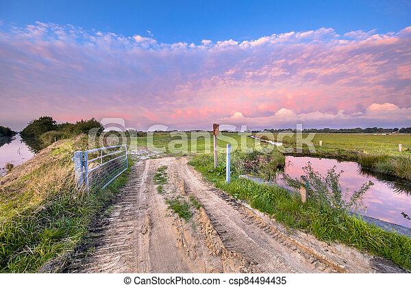 Sunset over meadows - csp84494435