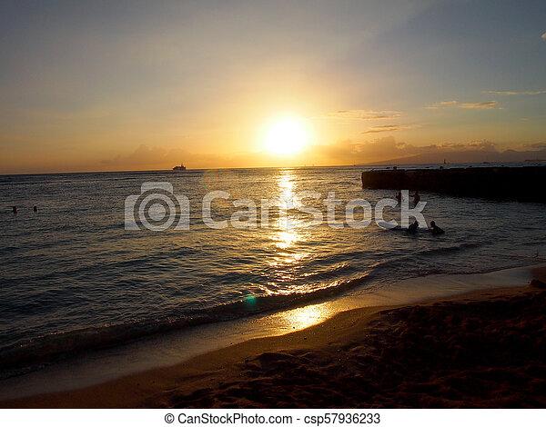 Sunset over ocean seen from Beach - csp57936233