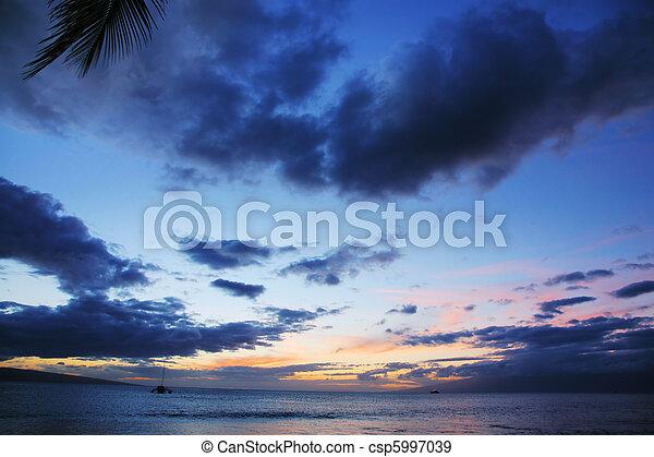 Sunset over ocean - csp5997039
