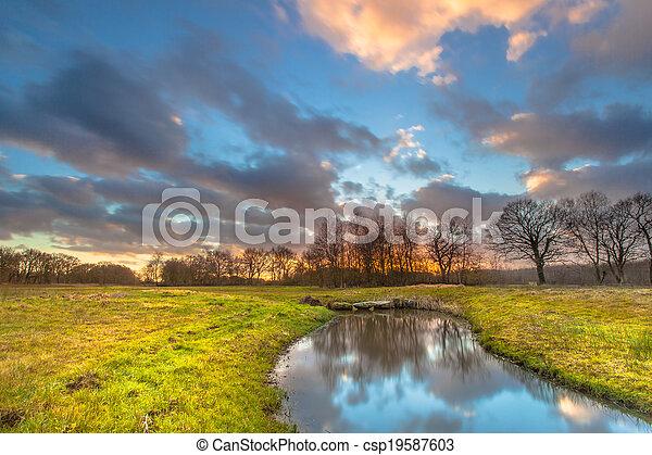 Sunset over River Landscape - csp19587603