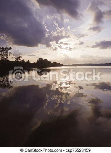 Sunset over Saganashkee Slough - csp75523459