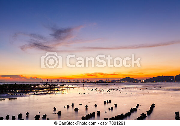 Sunset over sandy beach in low tide - csp17801261