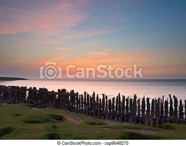 Sunset over sea Netherlands - csp9648270