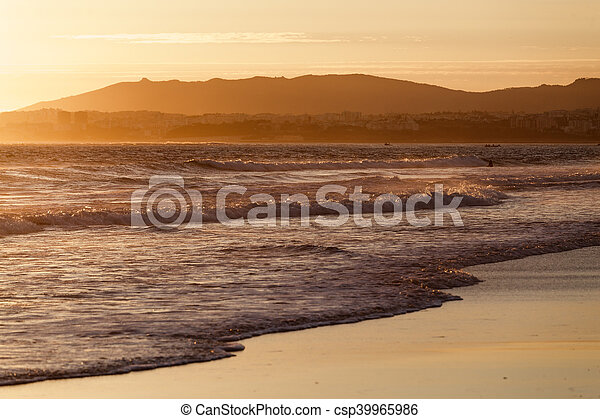 Sunset over the Atlantic Ocean off the coast of Portugal - csp39965986