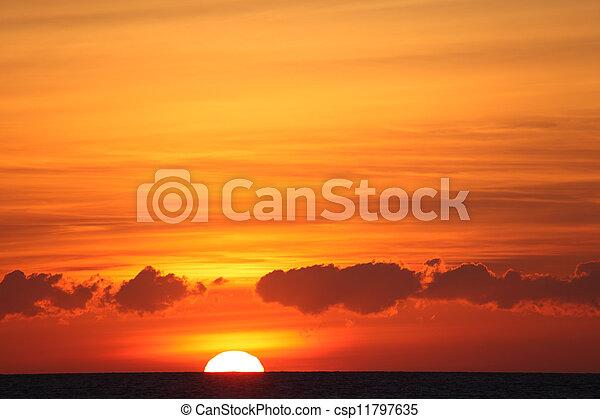Sunset over the Atlantic ocean. Photographed from Tarifa beach, Spain - csp11797635