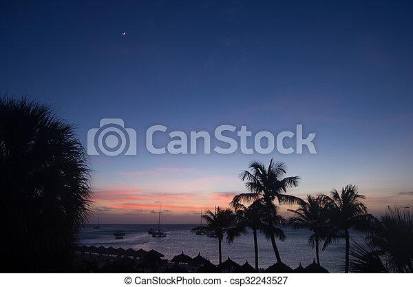 Sunset over the beach in Aruba - csp32243527