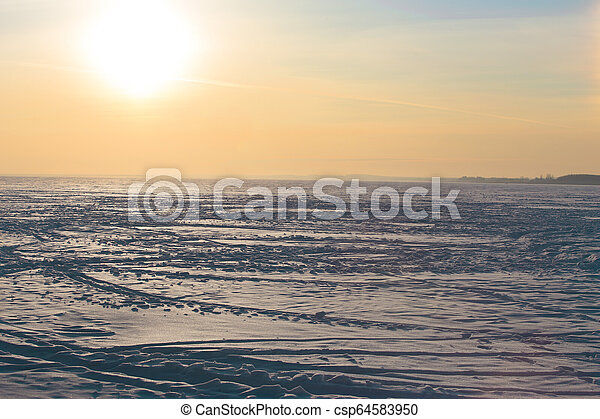 sunset over the frozen winter lake - csp64583950