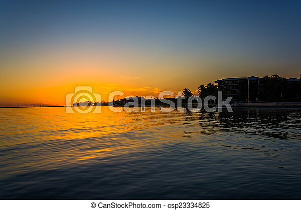 Sunset over the Gulf of Mexico from Smathers Beach in Key West, - csp23334825