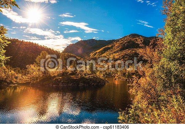 Sunset over the mountains of Lofoten islands - csp61183406