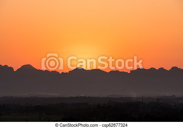 sunset over the mountains - csp62877324