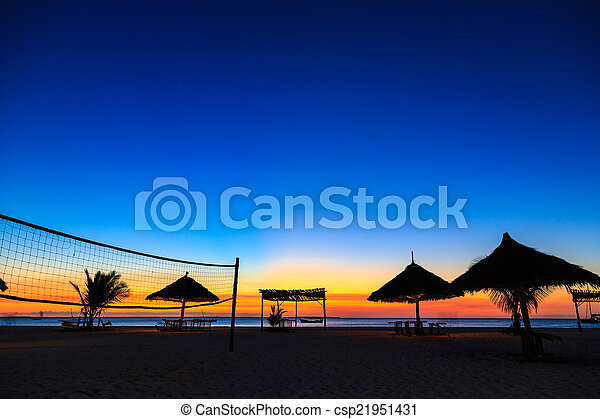 Sunset over the ocean at a resort - csp21951431