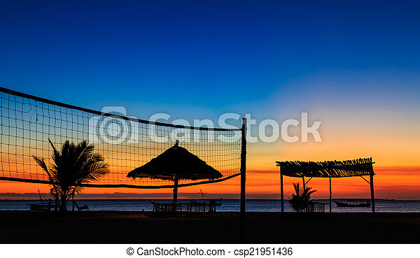 Sunset over the ocean at a resort - csp21951436