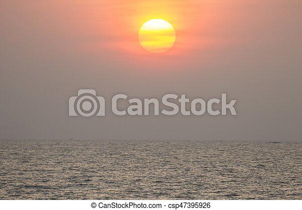 sunset over the ocean at Mumbai - csp47395926