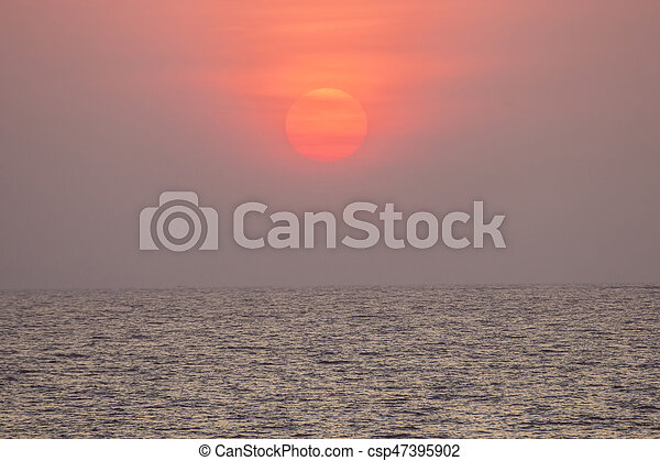 sunset over the ocean at Mumbai - csp47395902