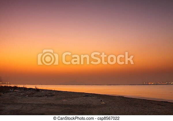 Sunset over the ocean in winter - csp8567022