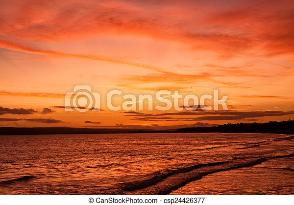Sunset over the ocean - csp24426377