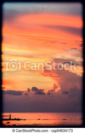 Sunset over the ocean - csp54634173