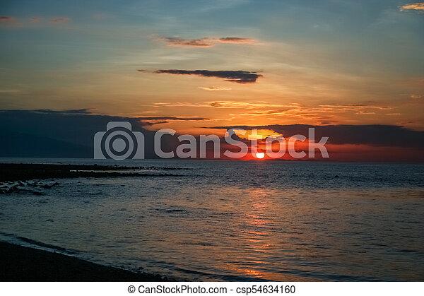 Sunset over the ocean - csp54634160