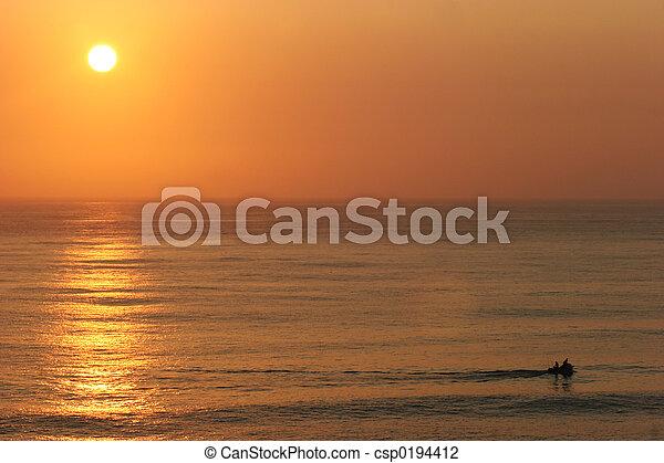 Sunset over the ocean - csp0194412