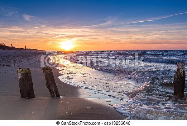 Sunset over the ocean - csp13236646