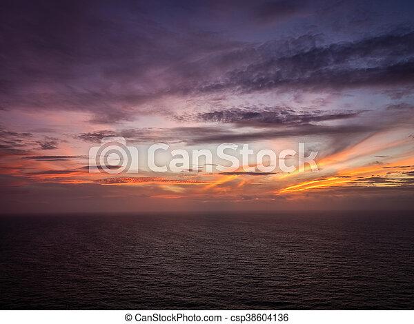 Sunset over the ocean - csp38604136