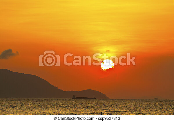 Sunset over the ocean - csp9527313