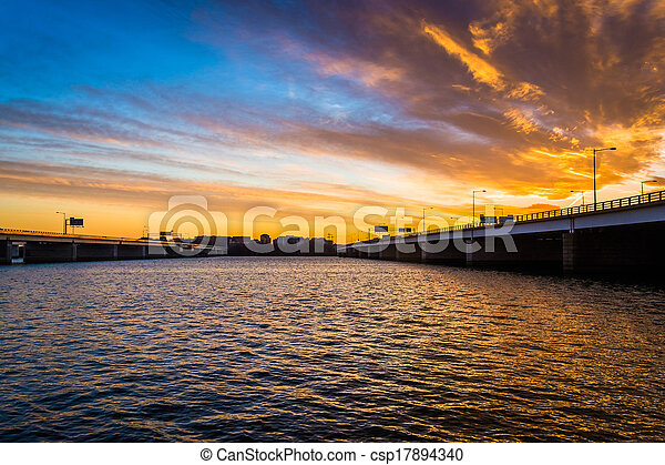 Sunset over the Potomac River and bridges in Washington, DC.  - csp17894340