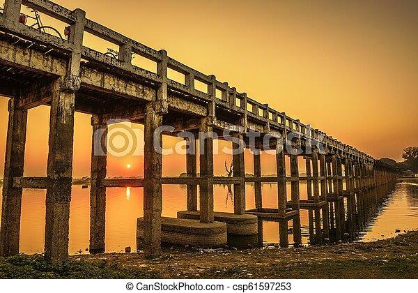 Sunset over the U Bein Bridge in Myanmar - csp61597253