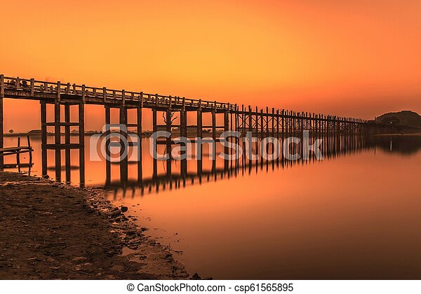 Sunset over the U Bein Bridge in Myanmar - csp61565895