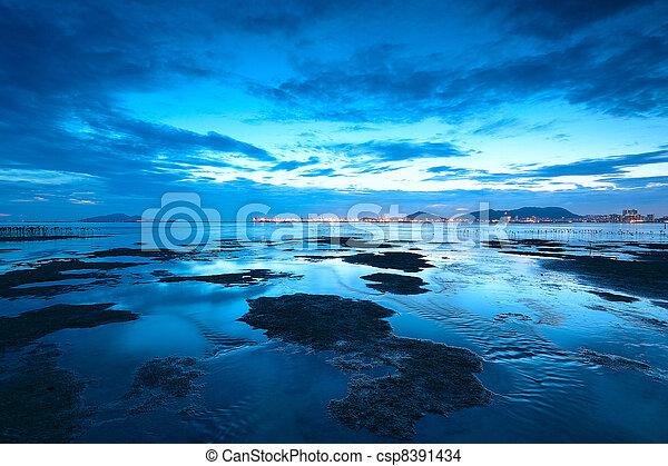 sunset shingle coast in hong kong  - csp8391434