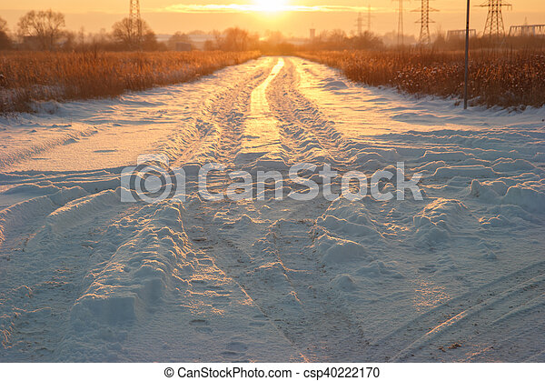 Sunset snowy road - csp40222170