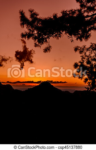 Sunset with mountain silhouette - csp45137880