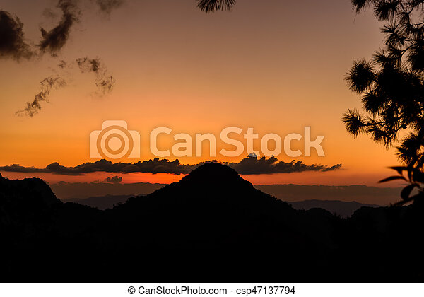 Sunset with mountain silhouette - csp47137794